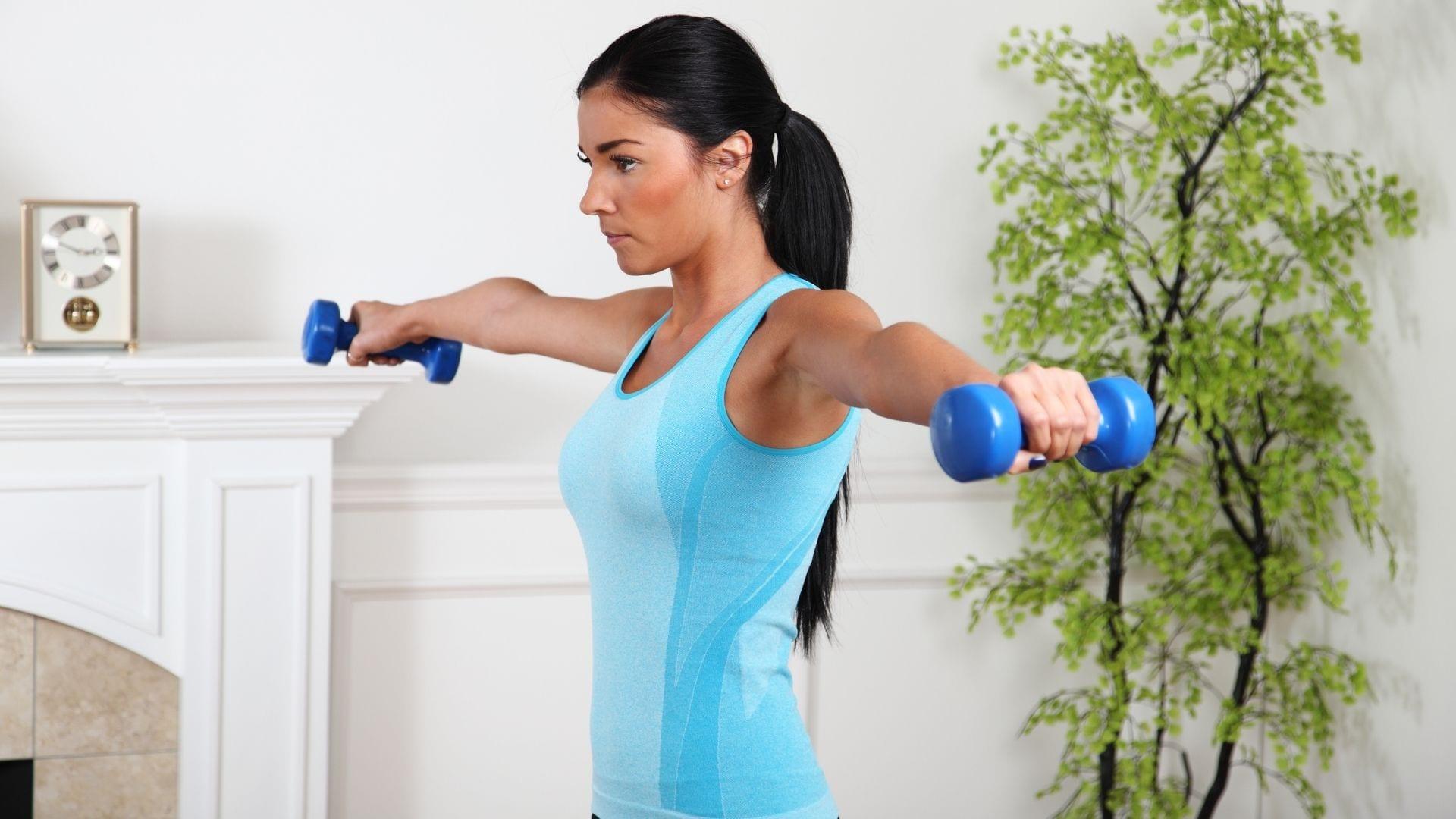 woman exercising and lifting weights