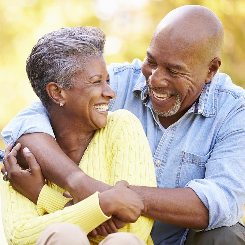 black man and woman hugging